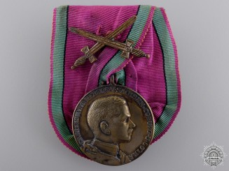 A Saxon Ernestine House Order; Silver Merit Medal