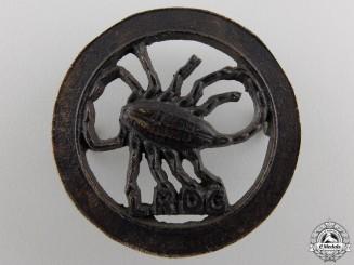 A Second War Long Range Desert Group Cap Badge