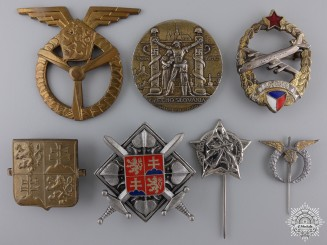 A Set of Seven Czechoslovakian Badges and Insignia