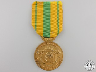 An Ivory Coast Medal of National Merit Medal; Gold Grade