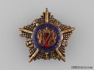 A WWII British Guards Machine Gun Battalion Officer's Cap Badge