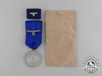 A Complete Wehrmacht Heer 4 Year Service Medal by Eugen Schmidhäussler