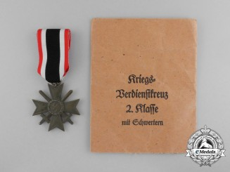 A War Merit Cross Second Class with Swords in its Original Packet of Issue by Wilhelm Deumer