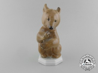 An SS Allach-Made Sitting Bear Figurine by Theodor Kärner