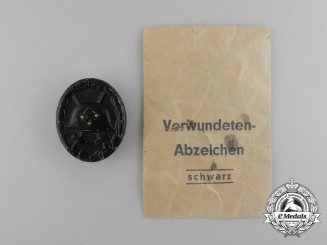 A Second War German Black Grade Wound Badge; Tombac Version in its Packet of Issue
