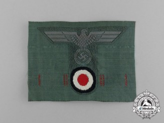 A Mint Wehrmacht Heer (Amy) Field Cap Insignia