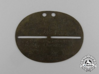 A First War German Identification Disc of Lieutenant of the Reserve Hans Wolters