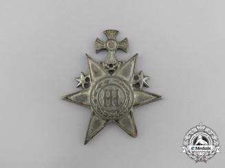 Montenegro. A NCO's Cap Badge c.1900