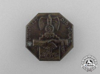 "A 1934 ""The Saar is German"" Celebration Badge"