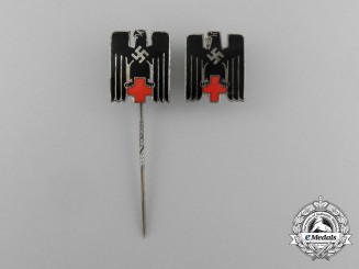 A Grouping of Two Second War German DRK (German Red Cross) Badges and Stick Pins
