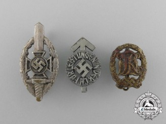 A Grouping of Three Second War German Lapel Badges
