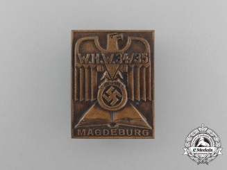 A 1934/35 WHW (Winter Aid of the German People) Magdeburg Donation Badge
