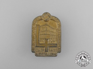 A 1938 Exhibition of the Occupational School and it's 4-Year Plan Badge by Wurster