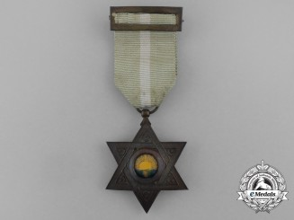 An Order of Mehdauia; Bronze Grade Breast Badge
