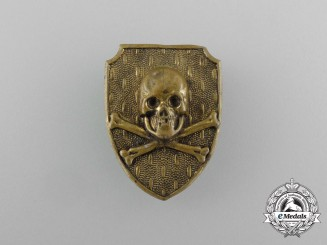 "A Unidentified Free Corps ""Death's Skull"" Cap Badge"