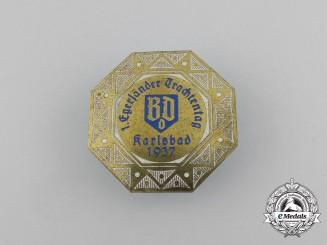 A 1937 Karlsbad 1st Egerländer Day of Traditional Dress Badge