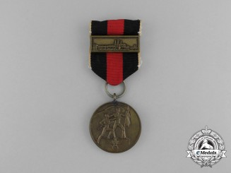 A Second War Sudetenland Medal with Prague Medal Bar