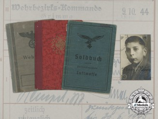 A Group of ID Books to Homeland Flak Helper Erhard Heinze