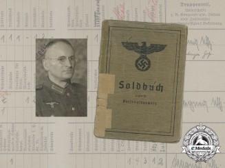 A Soldbuch to Wehrmacht Heer Infantry Obergefreiter Josef Hohlmeier