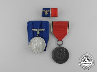An Wehrmacht Long Service Medal Pair with Ribbon Bar