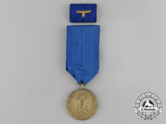 A Wehrmacht 12-Year Long Service Medal with Matching Boutonniere and Ribbon Bar