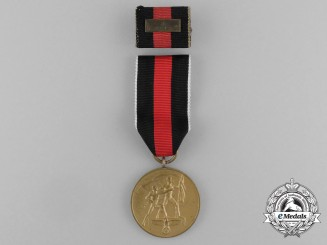 A Commemorative Sudetenland Medal with Matching Medal Ribbon Bar