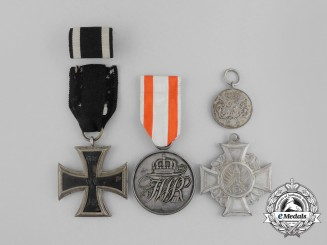 A Grouping of Four First War German Medals, Awards, and Decorations