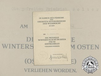 An Eastern Front Medal Award Document to Obergefreiter Friedrich Wolter