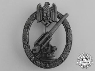 A Wehrmacht Heer Flak Badge by C. E Juncker of Berlin