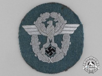 An Unissued German Police Officer's Bullion Sleeve Eagle; Standard Uniform