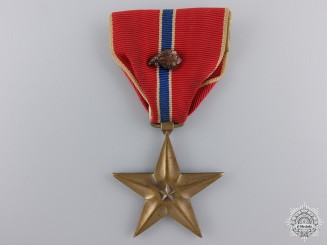 An American Bronze Star with Oak Leaf Cluster; Named