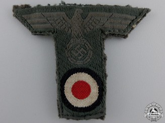 An Army Cap Eagle with Piece of Cap