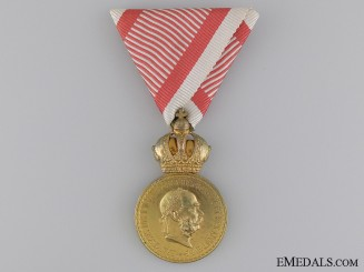"An Austrian Military Merit Medal ""Signum Laudis""; Bronze Grade,"