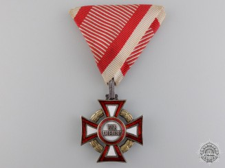An Austrian Military Merit Cross with War Decoration by A.E. Köchert