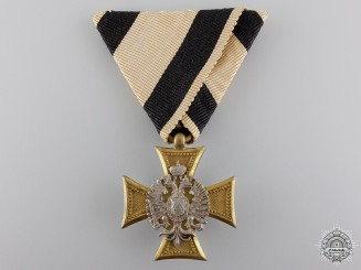 An Austrian Military Long Service Cross with Pearl Backing
