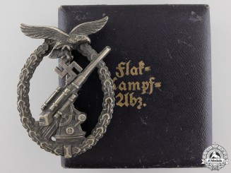 An Early Cased Luftwaffe Flak Badge by C.E.Juncker