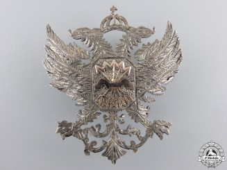 An Early Franco Period Falange Silver Badge