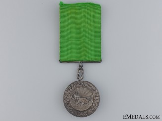 An Iranian Order of Homayoun; Silver Grade Medal