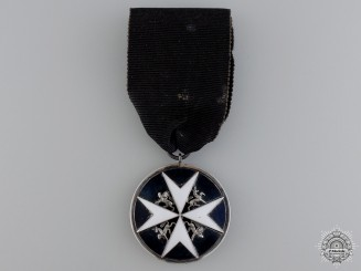 An Order of St. John; Breast Badge by J.R. Gaunt