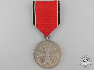 An Order of the German Eagle; Silver Merit Medal (835 PR. MUNZE BERLIN)