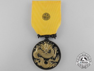 A Military Order of the Dragon Medal 1900 to Captain Charles H. Selwyn; 12th Bengal Cavalry