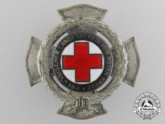 A Prussian Red Cross Ten Year Service Badge by Godet