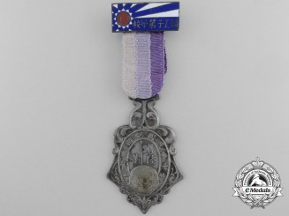 A Chinese Ministry of Finance Patriotic School for Workers Medal; 6th Class