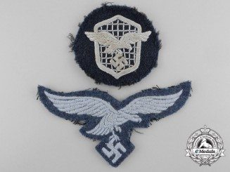 Two Luftwaffe Uniform-Worn Embroidered Insignia