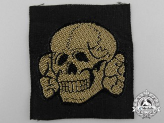 An SS Tropical Skull Cloth Insignia