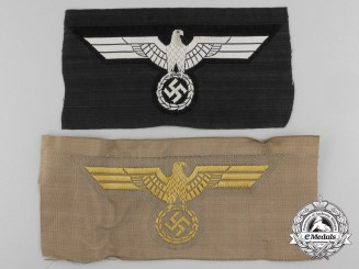 Two Mint German Army Eagle Insignia