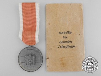 A German Social Welfare Medal by Godet with Packet of Issue