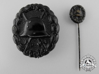 A First War Black Grade German Wound Badge with Miniature
