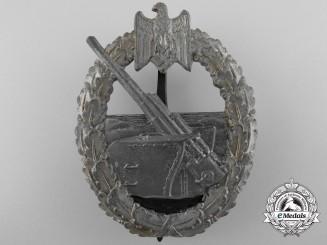 A Kriegsmarine Coastal Artillery Badge by Juncker