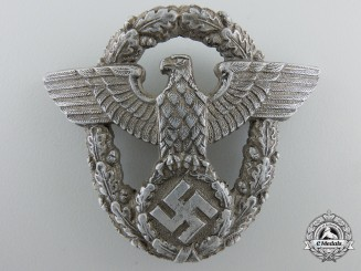 A Second War Period German Police Cap Badge by Assmann